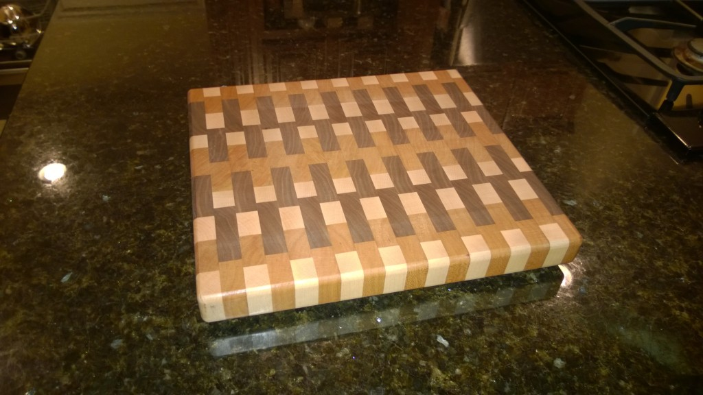 End grain chopping board in Maple, Cherry and Walnut